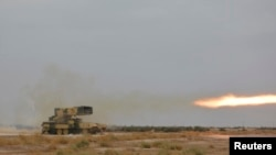 Iraq -- A Russian-made multiple rocket launcher known as the TOS-1A fires during training at a military camp in Baghdad October 14, 2014.