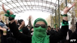 An opposition supporter gestures as she takes part in an anti-government demonstration on December 7 at Tehran University
