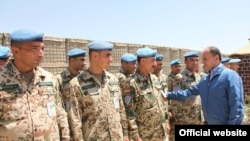 Armenian Defense Minister Seyran Ohanian inspects Armenian troops serving in Afghanistan in July.