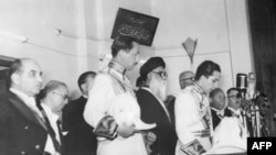 The young King Faisal II of Iraq (Hashimite monarchy) takes the oath at the age of 18, in front of the Parliament 05 May 1953 in Baghdad and replaces his uncle Amir Abd al Ilah who was made the Regent.
