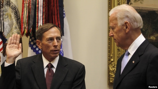 U.S. Vice President Joe Biden (right) swears-in David Petraeus as the new CIA chief at the White House in Washington, DC.