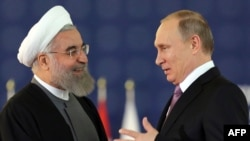 Friends and competitors -- Russian President Vladimir Putin (right) and his Iranian counterpart Hassan Rohani.
