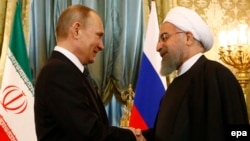 Russian President Vladimir Putin (left) meets with Iranian President Hassan Rohani at the Kremlin in Moscow on March 28.