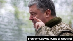 Ukrainian President Petro Poroshenko speaks to soldiers during a meeting at the headquarters of the antiterrorist operation of Donetsk and Luhansk oblasts in the Luhansk region on March 16.