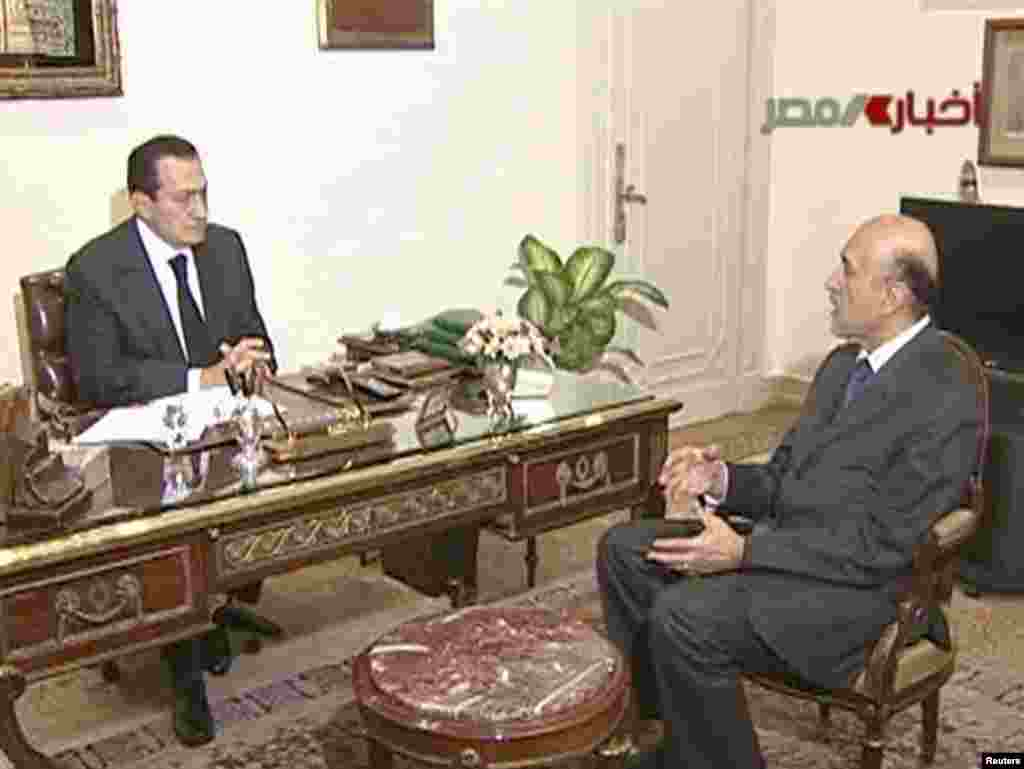 Mubarak speaks with Vice President Omar Suleiman in Cairo on February 10 during the crisis.