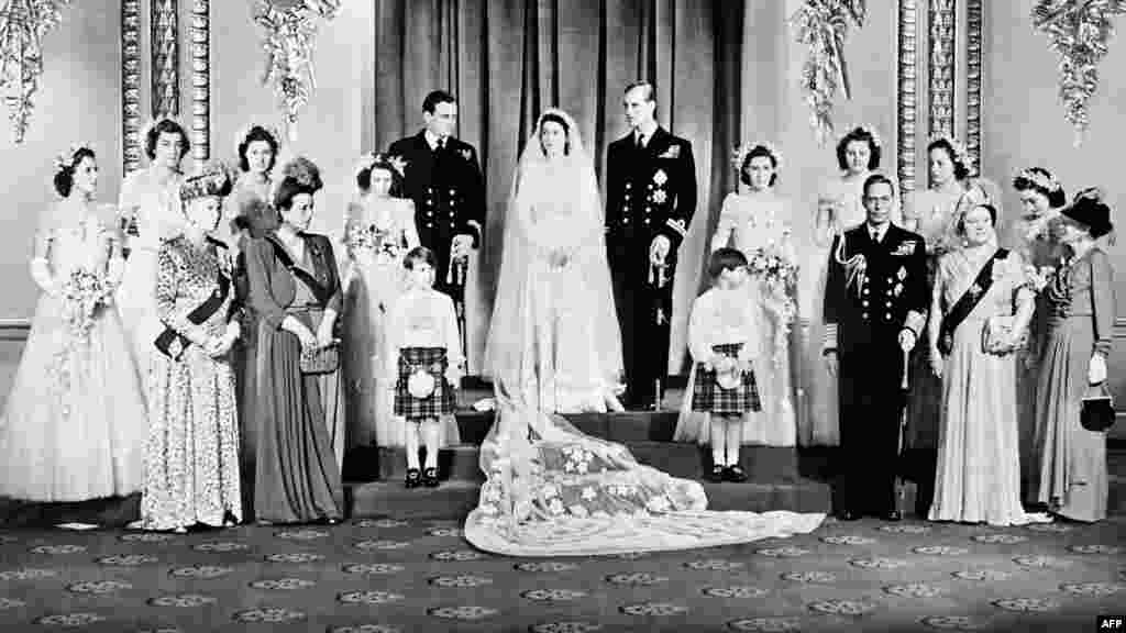 Members of the British royal family pose around Princess Elizabeth and Philip, Duke of Edinburgh, in the Throne Room at Buckingham Palace on their wedding day, November 20, 1947.