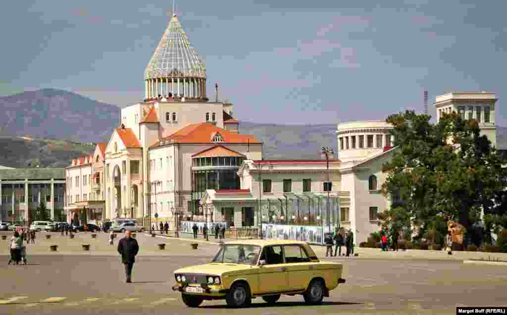 A car passes by the parliament of Nagorno-Karabakh. The region declared independence in 1991, a status that is not recognized outside its borders.
