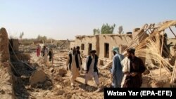 Afghan families displaced by fighting return to ruined houses in Bolan, a village near Lashkar Gah, capital of Helmand province