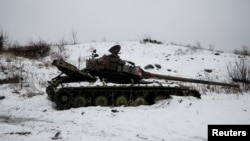 A destroyed Ukrainian tank is pictured on the front line near the government-held industrial town of Avdiyivka on February 4.