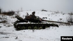 A destroyed Ukrainian tank on the front line near the government-held industrial town of Avdiyivka