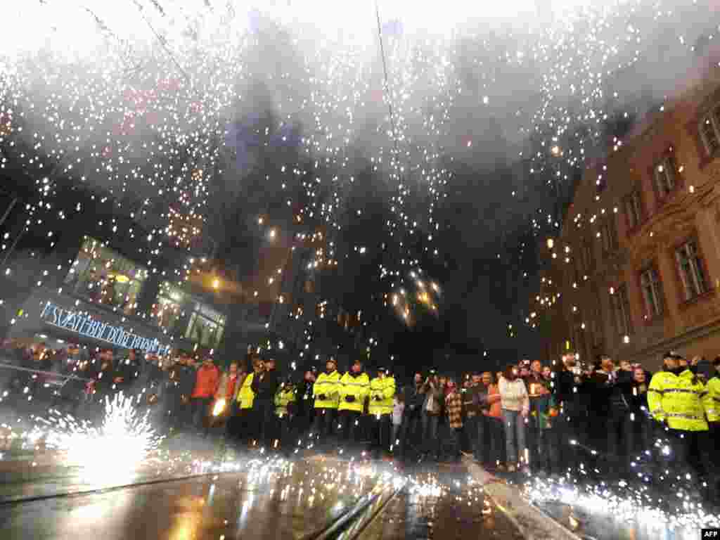 Czechs watch a fireworks display in downtown Prague symbolizing the fall of the Iron Curtain. - On November 17, the Czech Republic celebrated the 20th anniversary of the peaceful Velvet Revolution, set in motion by student protests on that day in 1989. Photo by Joe Klamar for AFP