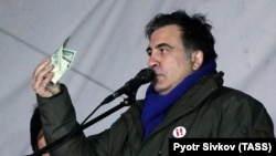 Mikheil Saakashvili speaks to supporters as they camp out outside parliament in Kyiv on December 6.