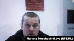 Russian opposition activist Leonid Razvozzhayev testifies in January via videolink.