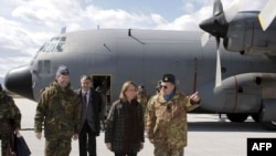 Spanish Defense Minister Carme Chacon (center) at the Djakoviva military base in northeast Kosovo
