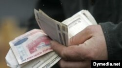 Belarus -- Belarusian money in hands, 28Feb2008