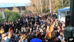 Dec. 30, 2017 file photo taken by an individual not employed by the Associated Press and obtained by the AP outside Iran, university students attend a protest inside Tehran University while anti-riot Iranian police prevent them to join other protesters