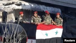 Prezident Başar al Assadyň tarapynda söweşýän esgerler, Kusair, 5-nji iýun, 2013.