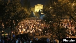 Supporters of Prime Minister Nikol Pashinian protest outside the parliament building in Yerevan on October 2.