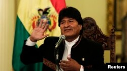 Bolivia -- President of Bolivia Evo Morales speaks during a news conference at the presidential palace in La Paz. Bolivia, October 13, 2014.