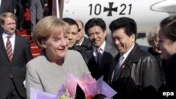 Китай -- Зустріч канцлера Німеччини Анґели Меркель у аеропорту Пекіна, 23 жовтня 2008 р.