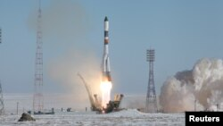 A Russian Soyuz booster rocket, carrying the Progress cargo space craft, blasts off for the International Space Station from the Baikonur cosmodrome in February 2017.