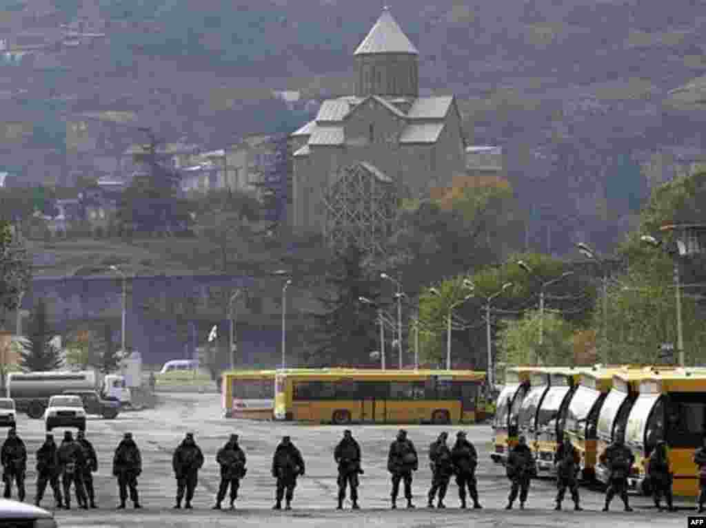 Georgian soldiers patrol a street in central Tbilisi on November 9, 2007. Georgian President Mikheil Saakashvili's chief of staff said that a nationwide state of emergency in Georgia will be lifted earlier than planned. Friday afternoon the Georgian parliament voted 149 to 0 in favor of endorsing the president's emergency decree.