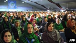 Female delegates listen to Afghan President Hamid Karzai's speech at the start of the peace jirga. Nearly one-fifth of the jirga's 1,600 delegates are women.