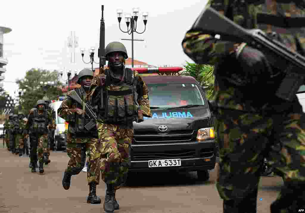 Military personnel mobilize on September 21 as militants battle security forces.