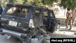 FILE: The aftermath of a bomb blast in the Afghan province of Khost.