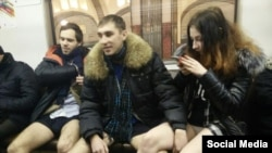 Moscow's police are said to be searching for some young men and women who posted photographs via social networks of themselves in underwear on the subway.