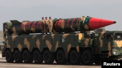 Pakistani military personnel stand beside a Shaheen-III surface-to-surface ballistic missile during a military parade. (file photo)
