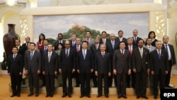 Chinese President Xi Jinping (center-front) poses for photos with the guests of the Asian Infrastructure Investment Bank (AIIB) in the Great Hall of the People in Beijing in October 2014.