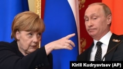 RUSSIA – German Chancellor Angela Merkel gestures at a joint news conference with Russian President Vladimir Putin in the Kremlin in Moscow, Sunday, May 10, 2015