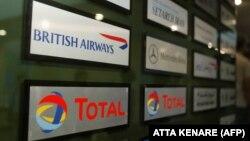 نشانهای توتال، بریتیش ایرویز، بنز و دیگر شرکتهای اروپایی در محل استقرارشان در برج سایه تهران.