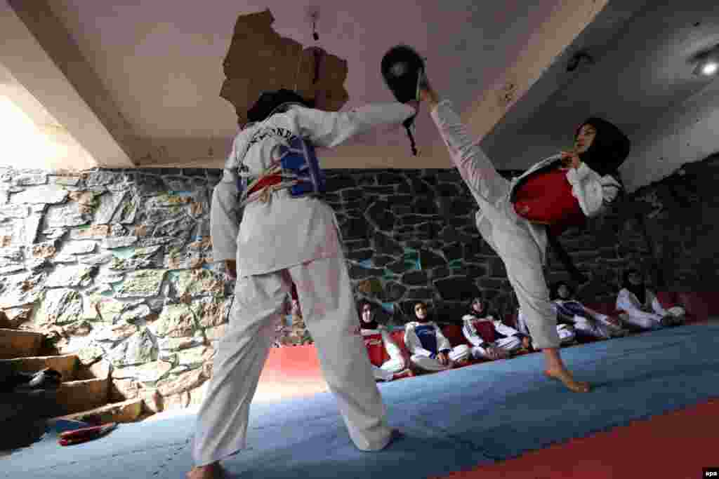 Afghan girls practice taekwondo during a martial arts class in Herat. (epa/Jalil Rezayee)