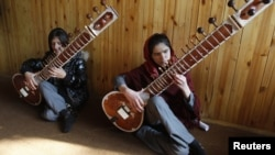 Students at the Kabul Music Academy play sitars.