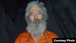A photograph of Robert Levinson received by his family in April 2011.