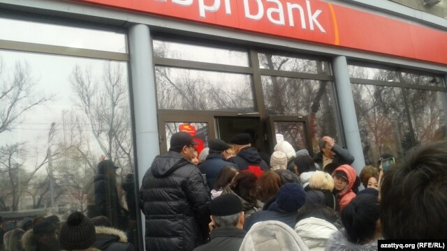 The tenge's devaluation has triggered a series of public protests in Almaty, as well as a bank run by panicked savers on three private banks on February 18.