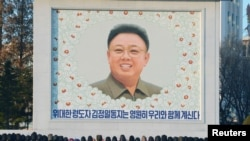 People bow in front of a portrait of late leader Kim Jong Il in Pyongyang.