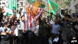 Demonstrators burn a U.S. flag during a protest near the Swiss Embassy in Tehran in 2012.