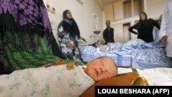 A newborn baby is seen in a hospital in the eastern city of Deir al-Zour on September 20 as Syrian government forces continued to press forward with Russian air cover in an offensive against Islamic State extremists.