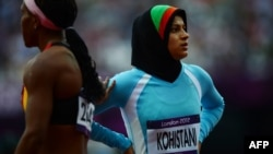 Afghanistan's Tahmina Kohistani (right) despite failing to qualify, ran a personal best time of 14.42 on August 3.