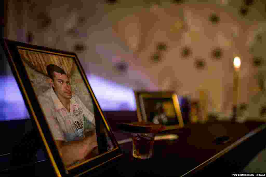 A small makeshift shrine in the home of Konstantin Momot, who was killed in Severnaya coal mine gas explosion