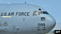 U.S. soldiers board a plane to Afghanistan from the Manas air base.