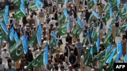 Activists of the Jamaat-e Islami Pakistani group shout slogans against the reopening of the route for NATO supplies to Afghanistan during a protest in Lahore on March 23.