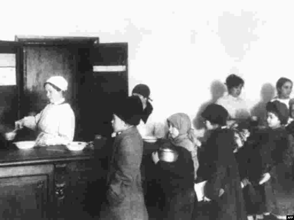 Residents of Petrograd line up at a soup kitchen in 1918 - In addition to the Whites, the Soviet government had to contend with military interventions from nine foreign states, including Japan, the United States, and Great Britain. By the end of the civil war in 1923, an estimated 20 million people had died from all causes, including fighting, famine, and disease. The economy was devastated and agricultural production was about one-third its pre-World War I level.