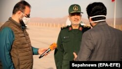 IRGC commander Hosseini Salami speaks to reporters after the launch of a rocket carrying a satellite at an undisclosed site on April 22.