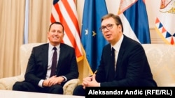 U.S. presidential envoy Richard Grenell (left) with Serbian president Aleksandar Vucic in Belgrade on October 10.