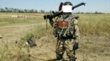 A Belarusian fighting Kremlin-backed separatists with Ukrainian far-right volunteers spoke to the media in 2015, but was it Raman Pratasevich?