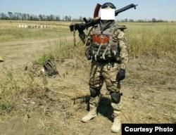 Белорусский боец украинского добровольческого батальона «Азов», член группы «Погоня». Позывной «Ким».